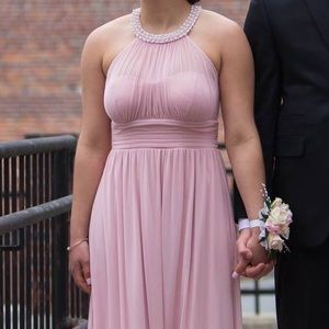 Long, blush pink, flowy prom dress.